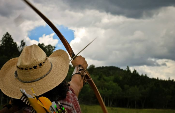 Can you shoot a bow with a hat on