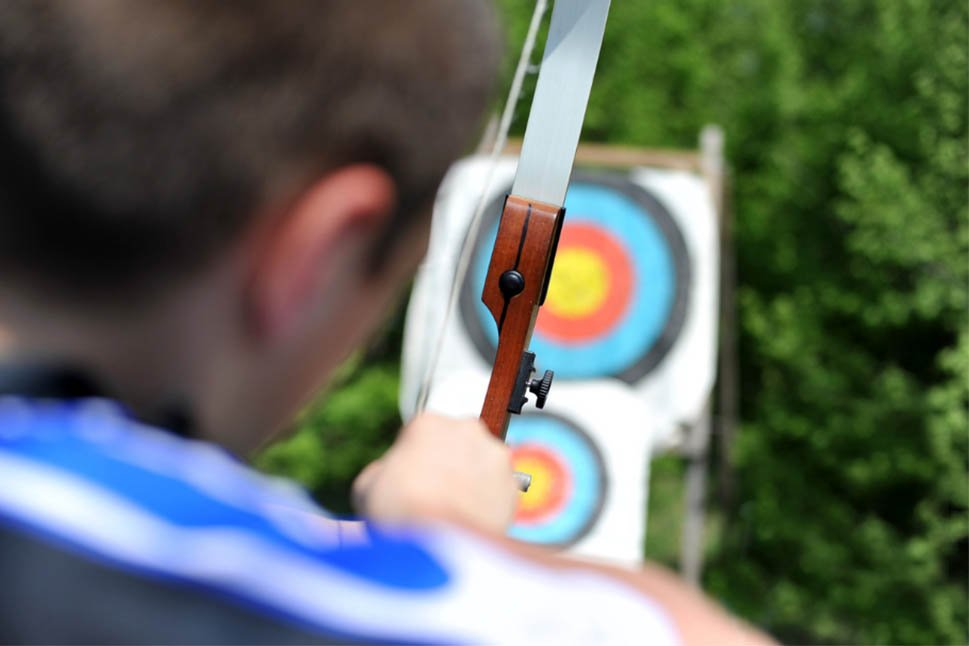 What does 5 or more whistles mean in archery