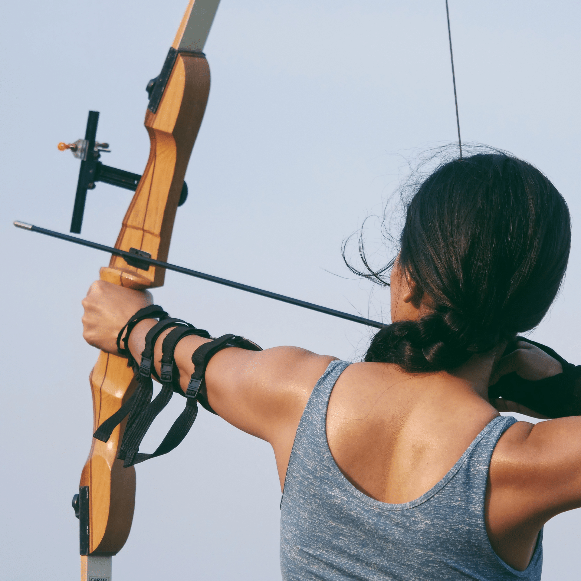 woman shooting a recurve bow