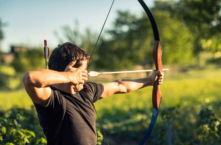 Which hand holds the bow in archery