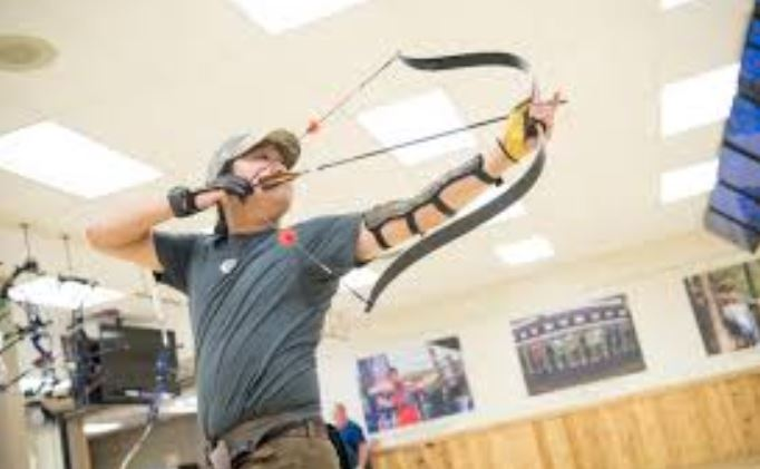 Why do archers wear arm guards