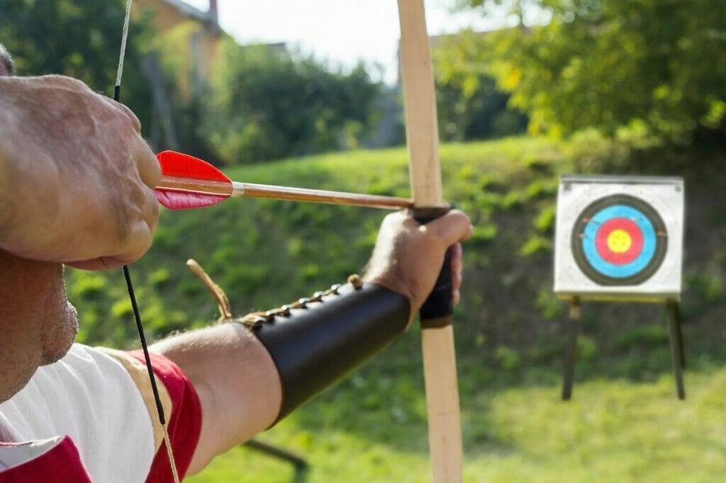 Why do archers wear bracers?